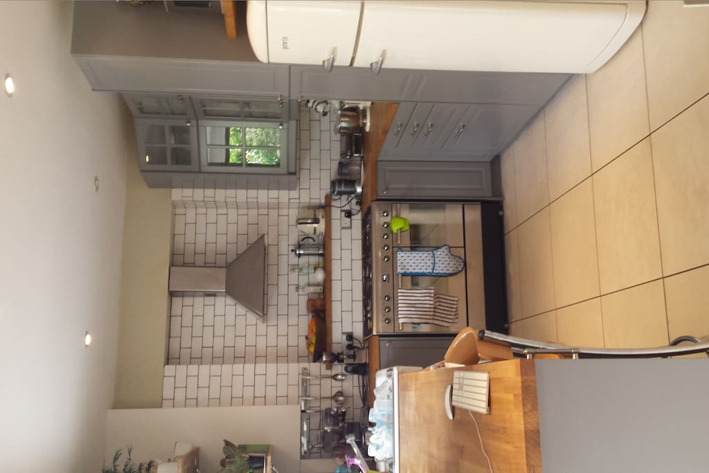 Kitchen including Smeg oven, Ascaso coffee maker, microwave & washer/drier & fridge