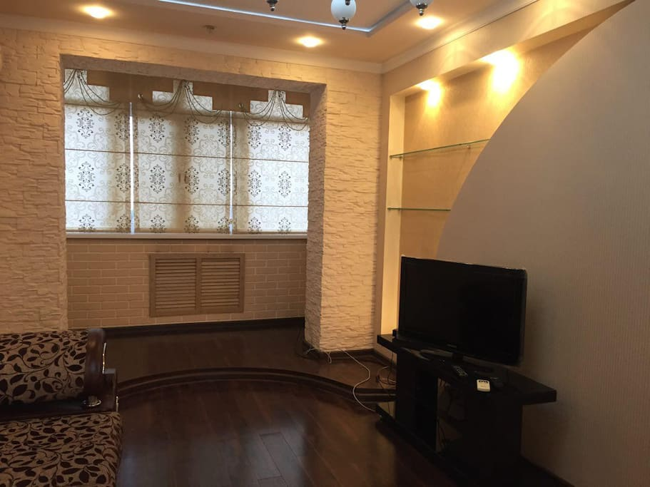 Comfortable living room with flat screen TV and satellite channels