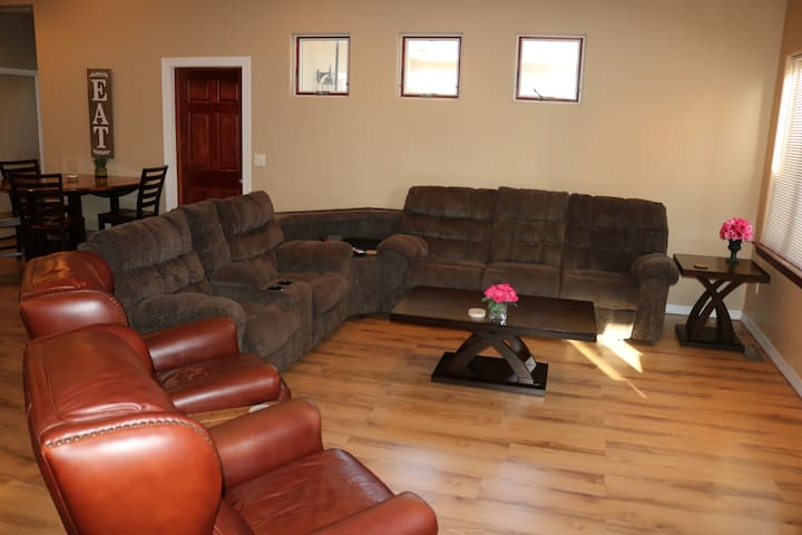 Living room with recliner sofa and two leather recliners