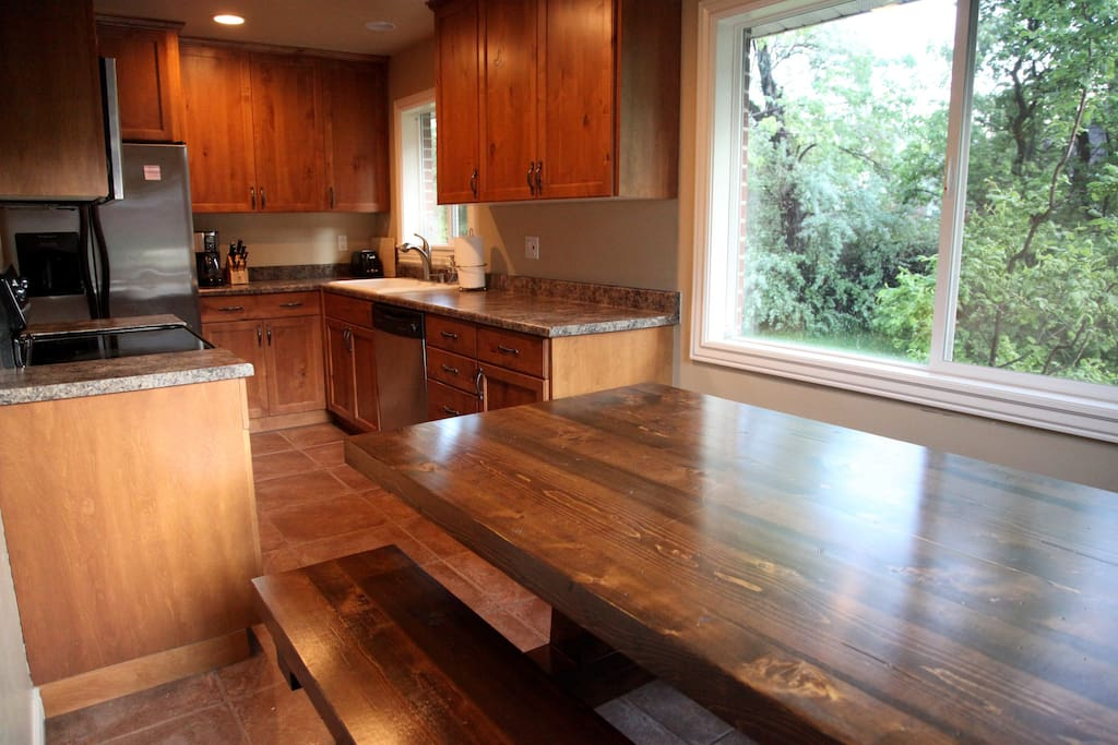 Clean modern kitchen with all the dishes and appliances you need