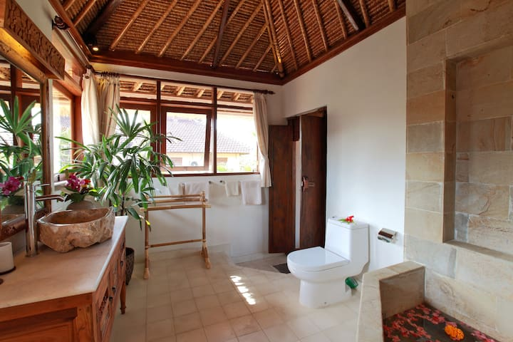 The bathroom has a large Japanese onsen type bath and separate shower. Light, bright and private.