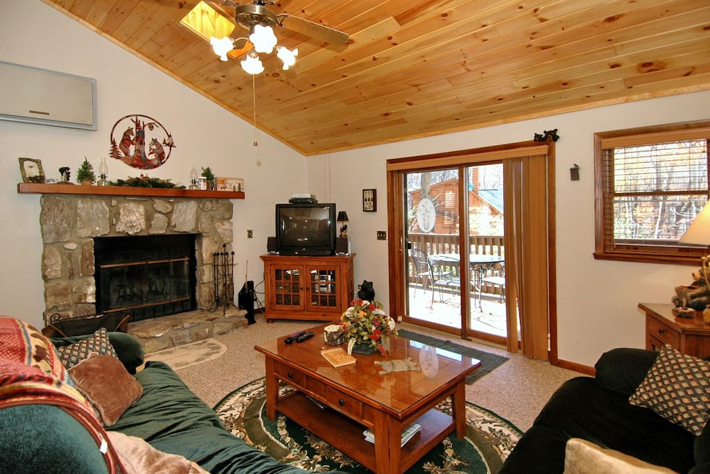 Wood burning fireplace with wood ceilings