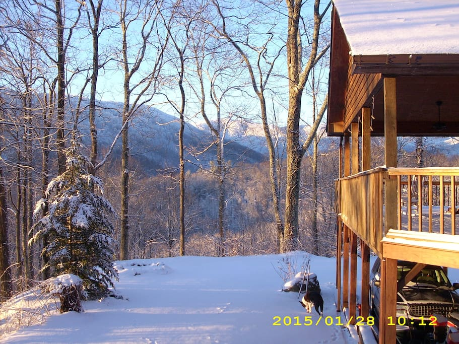 mountain views. nearest neighbor 1/2 mile away. 1 mile private unpaved road leads up to this home.  NO TRAFFIC NOISE.