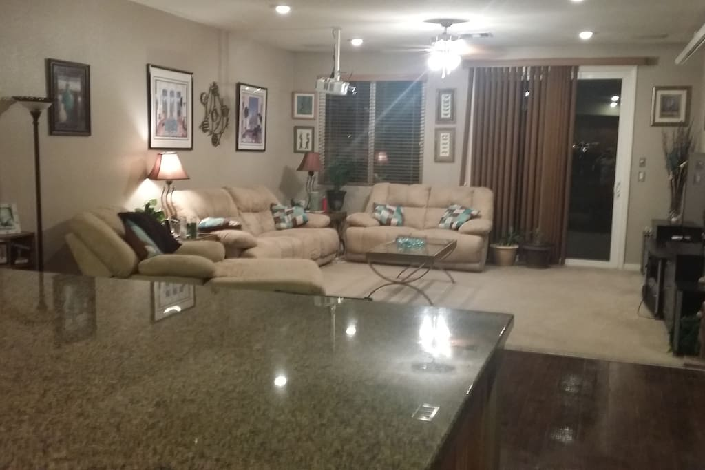 Family Room with Recliners, 60 inch Flat screen TV and Dish network. plus 10 foot projection screen TV for Movies.