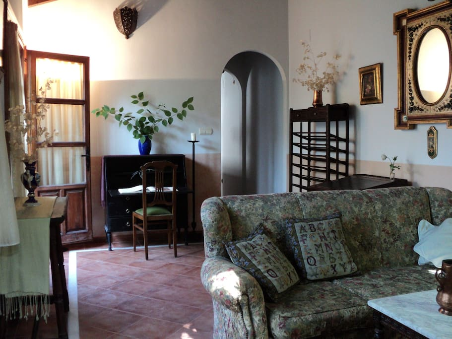 Living room with two French Doors that open to the garden.