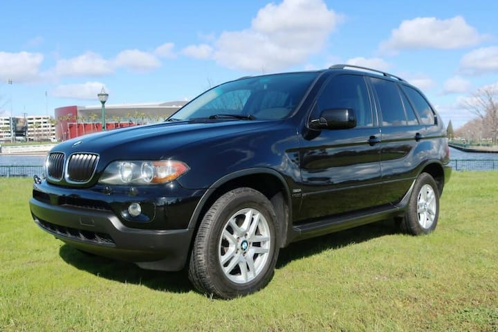 BMW X5 with camping gear, airport pickup/drop-off.