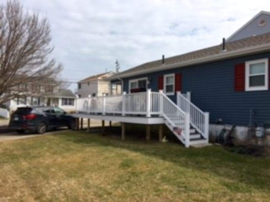 Exterior of house (wrap around porch with patio set & grill)