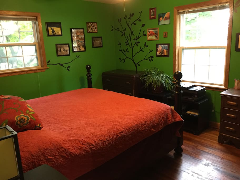The green room is the main bedroom with king size bed.