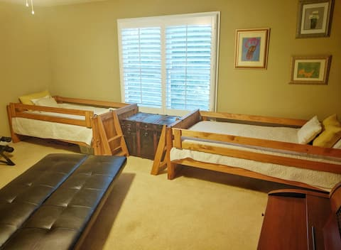 Two twin beds in one room in house near Lakepoint.