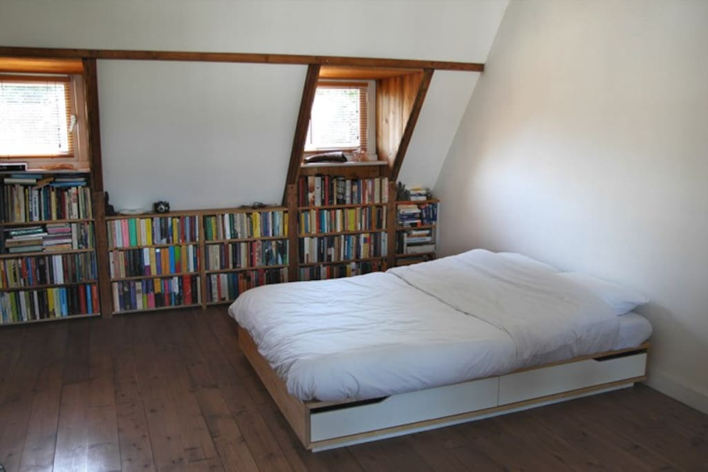 Bed for two and lots of books to read.