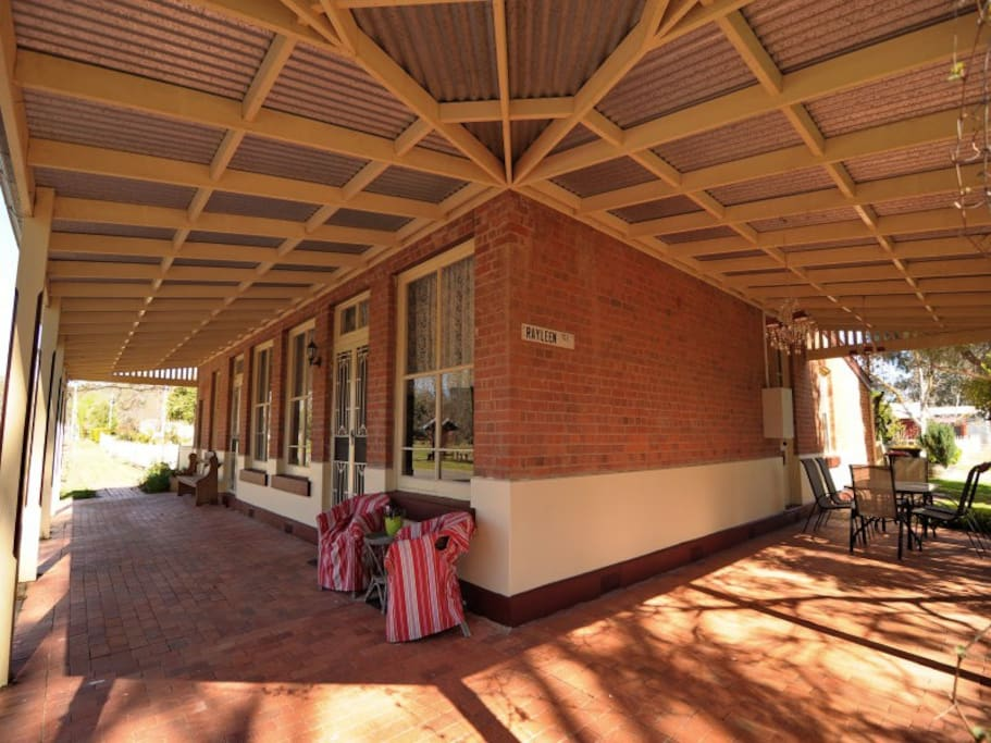 The large verandah, shaded by an old Jacaranda tree is a lovely place to sit and relax.