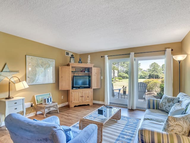 The large sliding door at 1749 Bluff Villa makes the living area bright and open.