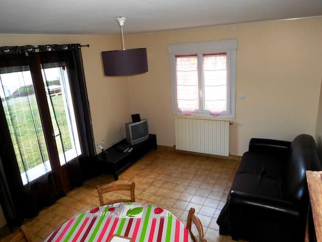 Bel appartement en rez de jardin