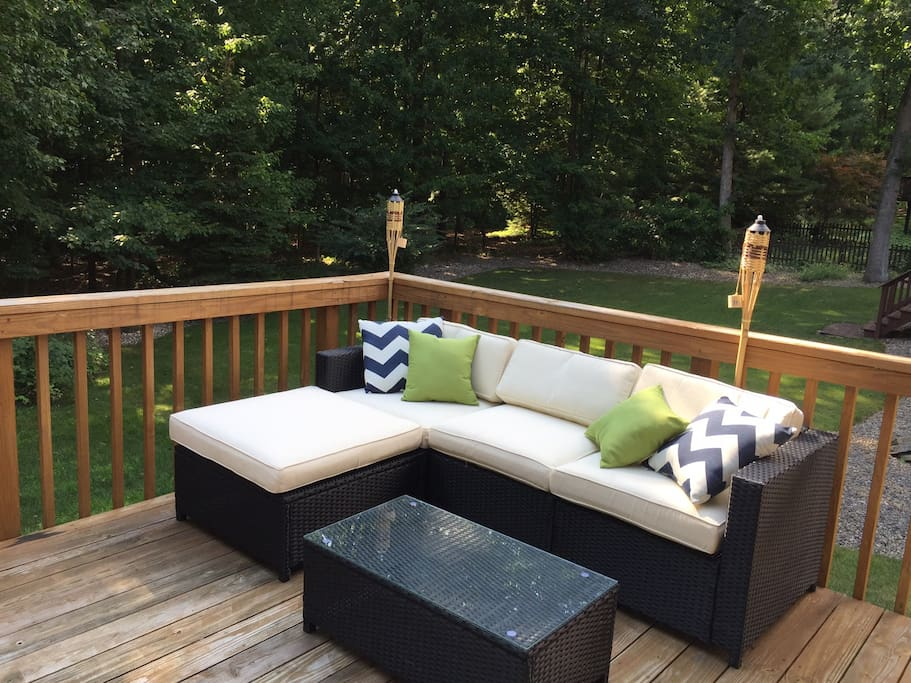 Enjoy a quiet evening on the back deck with a lovely view - perfect for relaxing after a busy Happy Valley day.
