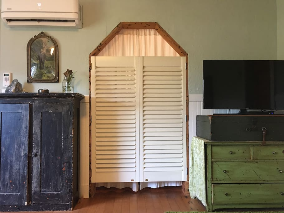 Shutter doors and curtains to nook.