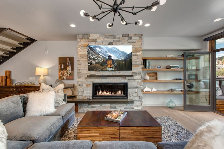 """Living Room with 65"""" Smart TV with YouTube TV, Netflix and Amazon Prime, Gas Fireplace,  and Patio Access"""