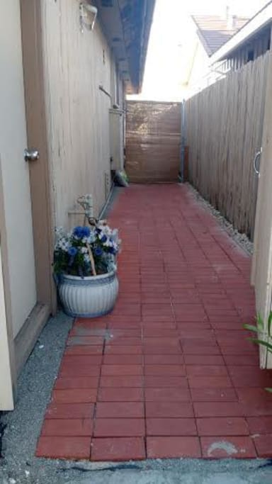 When you enter the gate from the street, this is the side yard leading up to the deck to your private room