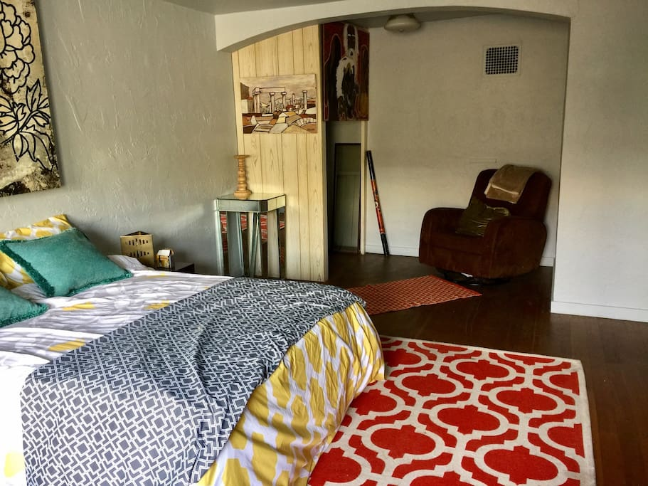 double bed, recliner chair, closet for hanging clothes