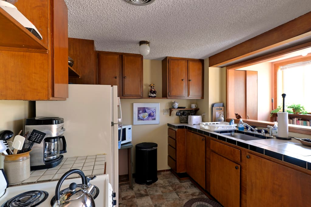 The kitchen has a counter microwave, toaster and coffeemaker.