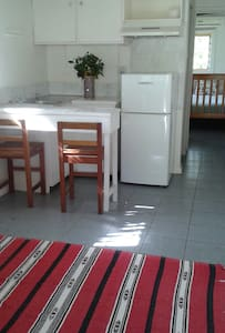 In a quiet and picturesque neighborhood, a peaceful retreat for two, with spacious air-conditioned bedroom, living area, restroom and shower. Apartment comes with fridge/freezer and microwave. Washing machine and tumble dryer also available.