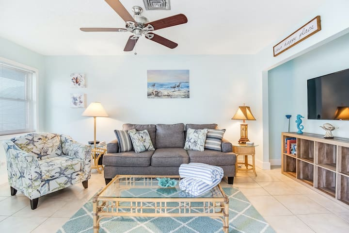 Breezy condo with shared pool - minutes from beach, shopping, and dining