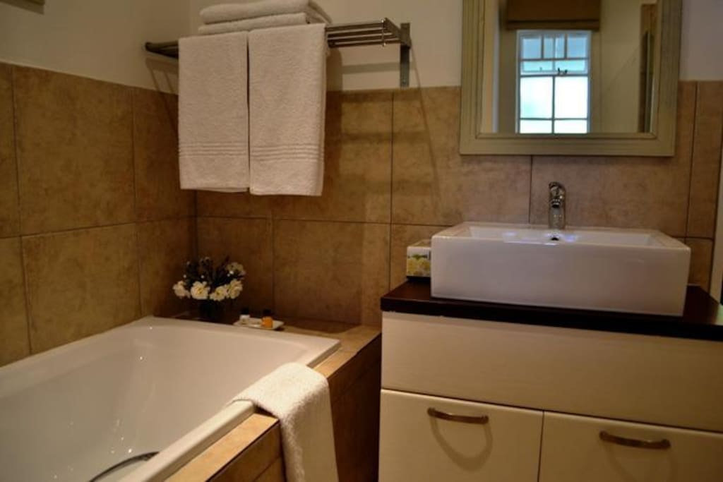 Bath and Shower in each room