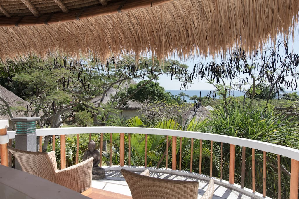 Breathtaking ocean view from the thatch-roofed balcony of your unique eco-loft room!