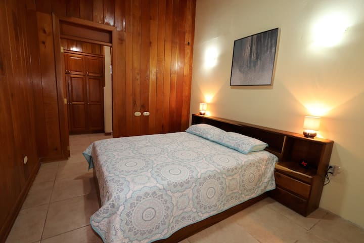 Bedroom #3, features a queen bed, made by a local artisan. All bedrooms have lamps and multiple plug ins for your phone, laptop, alarm clock and lamp.