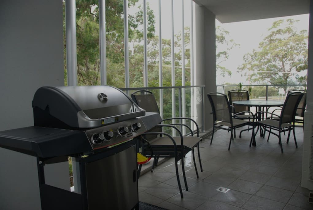 Spacious balcony with waterviews, outdoor setting and BBQ.