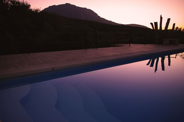 Villa with pool surrounded with mountains views