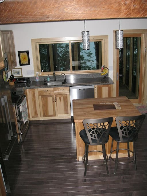 Kitchen has all new appliances, an island and access to screened in porch