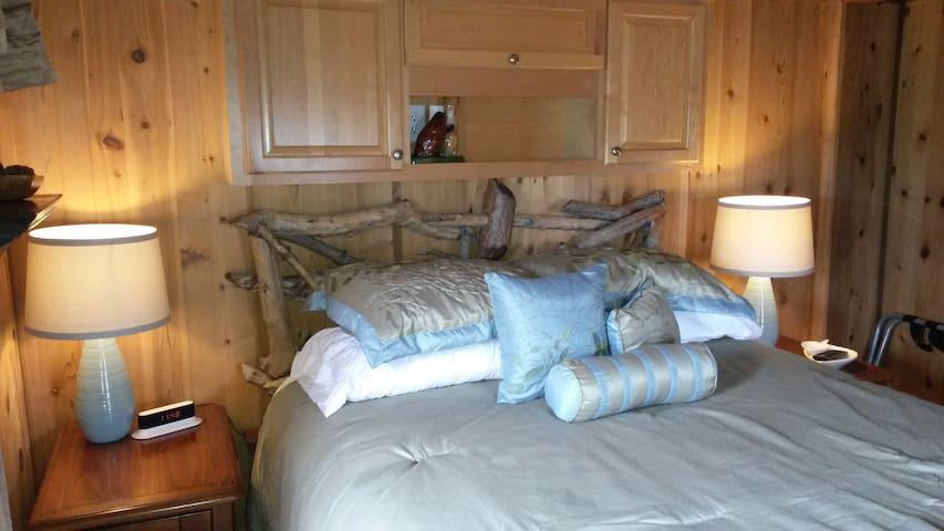 Master Bedroom with beaver wood headboard