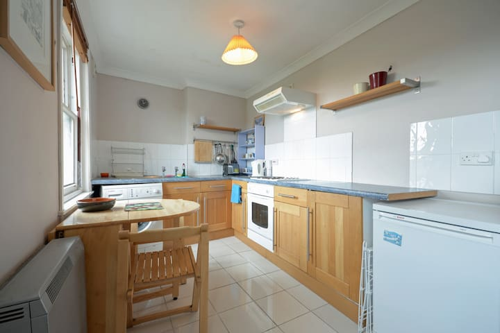 The kitchen has a fridge freezer, electric cooker, microwave, kettle, toaster and (clothes) washing machine. There are basic cooking utensils and cutlery and crockery. There is also a drying rack, steam iron and ironing board for clothes.