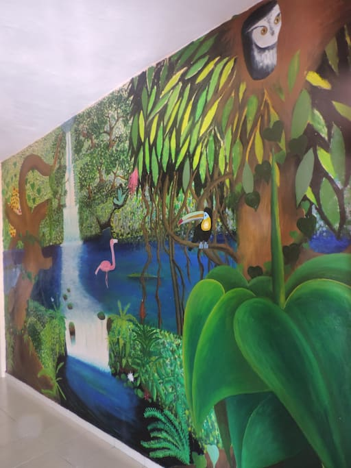 The living room wall features a mural done by a local artist!