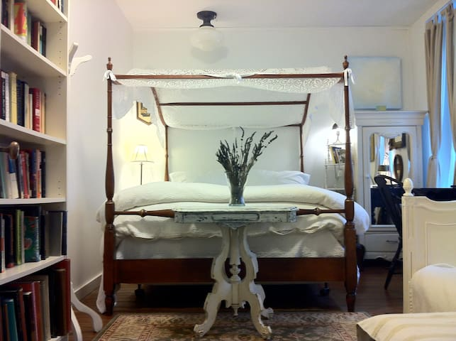 The library room has a queen size bed and a settee which is also a single bed and an en-suite bathroom