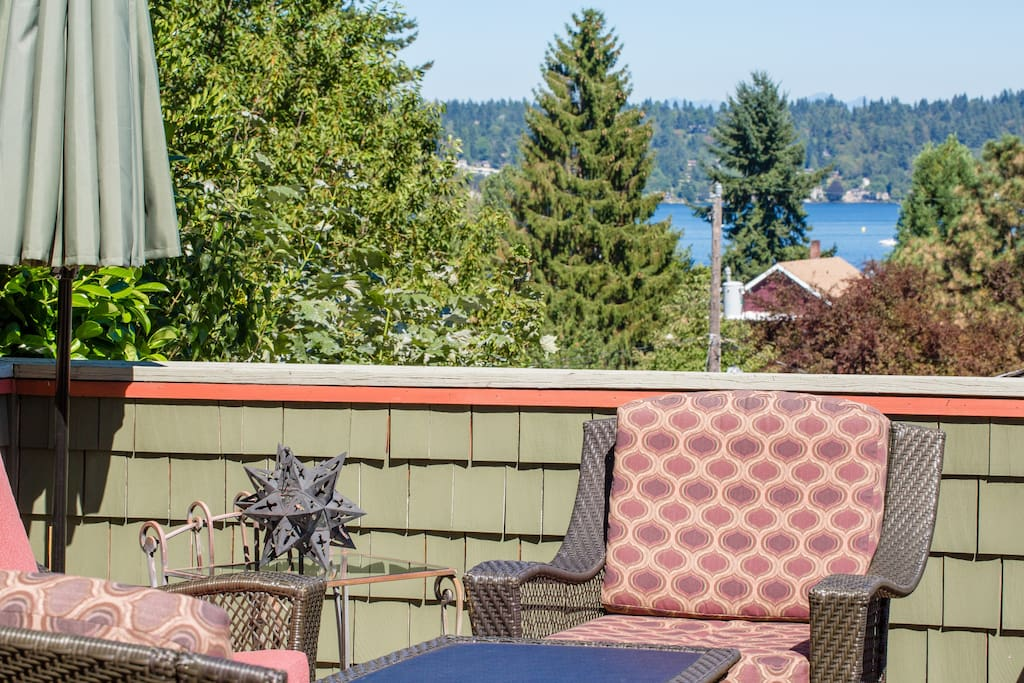 Lake views provide relaxing outdoor living and the 600 sq ft deck has lots of privacy, dining table and cozy outdoor furniture
