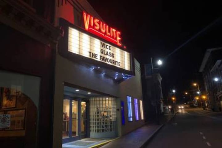 The iconic Visulite movie theater is the classic old-timey, home town theater where you can get real butter on your popcorn and even order from their wine and beer menu for your movie.