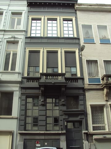 The studio is located on ground floor of a typical city house.