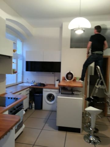 The kitchen with dishwasher and electric oven..