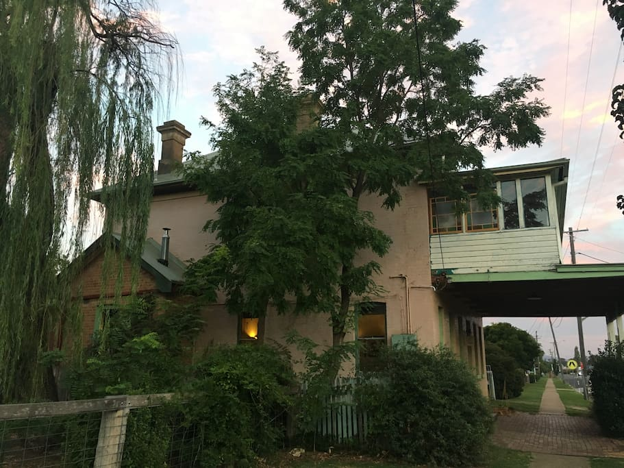 side view of the house, surrounded with a plethora of trees