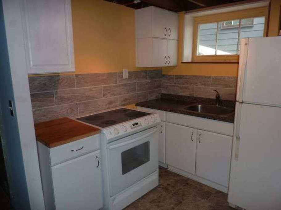 Kitchen with amenities.