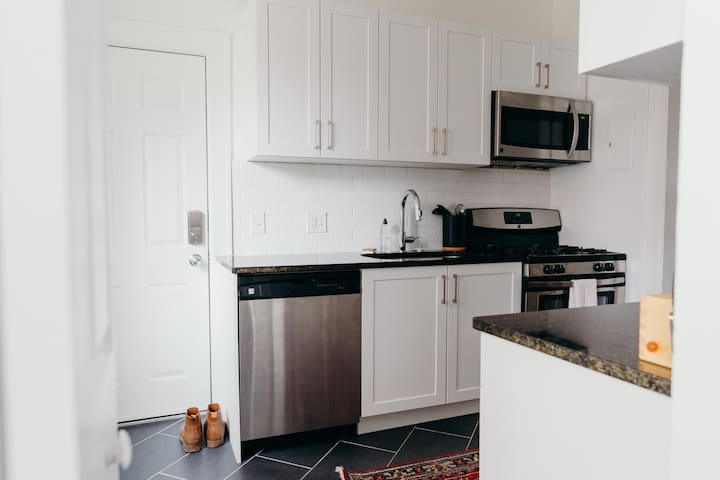 Galley kitchen with everything you need to make your stay perfect. Coffee, tea, gas range, dishwasher and full-size appliances.