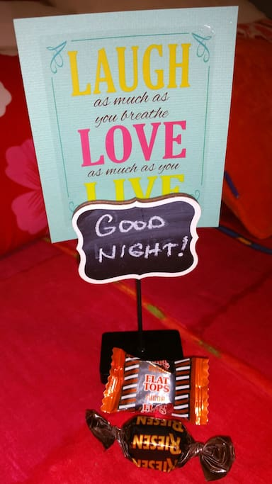 Good night note with chocolate candy in bed