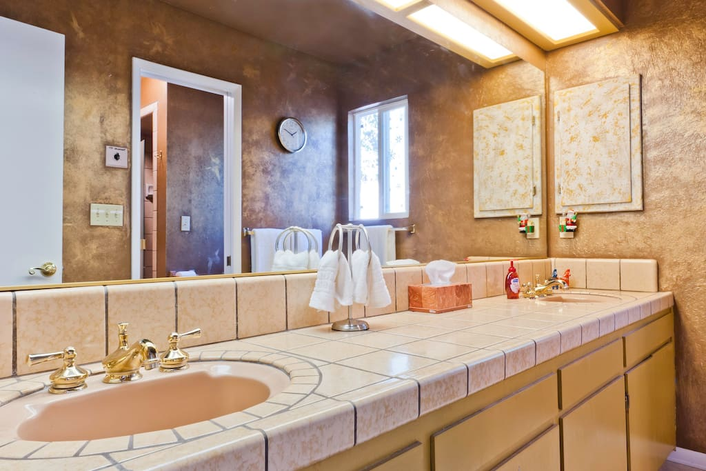 Spacious bathroom with double sinks, jetted tub, separate shower and wall heater for chilly nights!