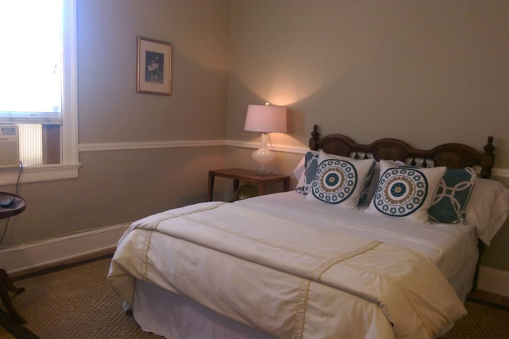 This bed was replaced with Queen size sleigh bed. Bright bedroom with two large windows, two closets.