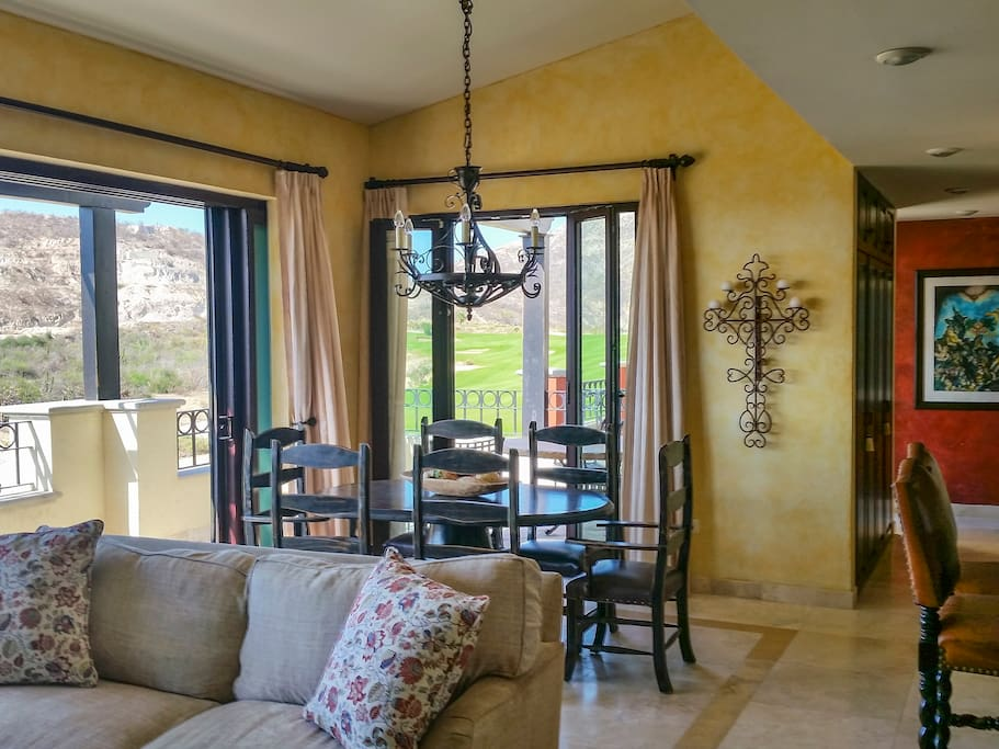 Comfortable living and dining area, 18 foot wide pocket doors open to private balcony with sweeping Sea of Cortez views