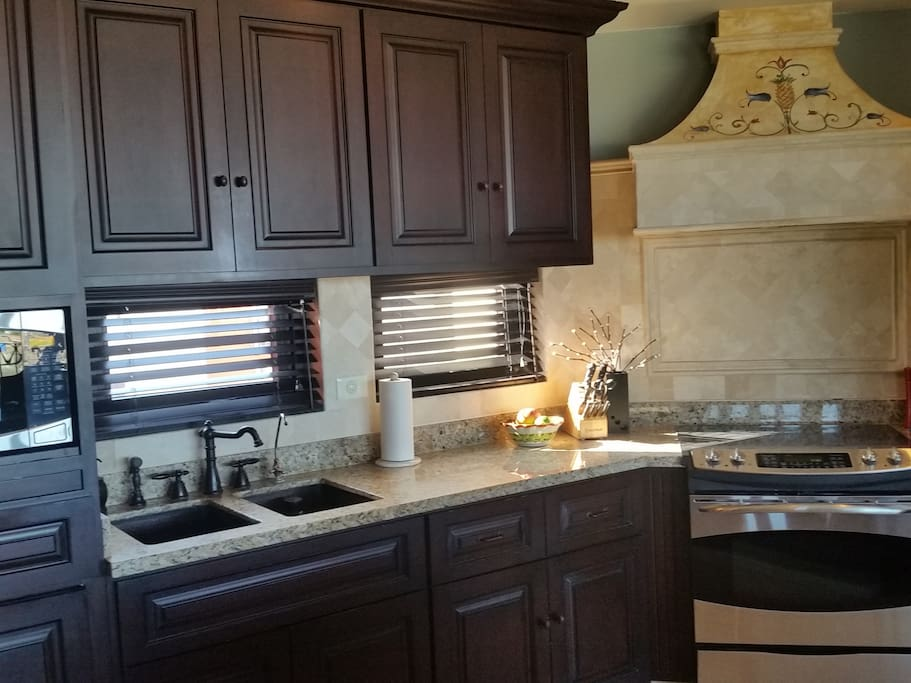 Modern kitchen, granite counters, quality appliances, cooking utensils, filtered water