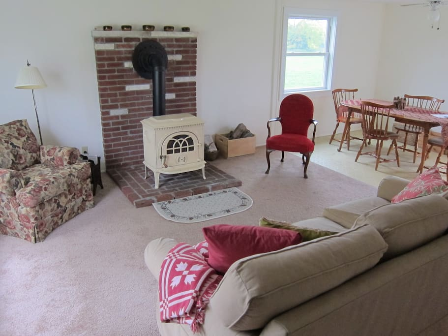 The living and dining areas have lots of light, with east, south, and north windows.  The Jotul stove makes for cozy winter evenings (wood is provided).