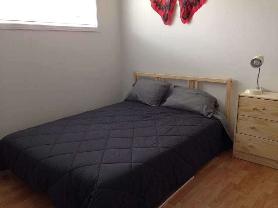 Open bedroom 2/den has double bed, lighting, lockable cabinets. Desk available upon request for stays >1 week.