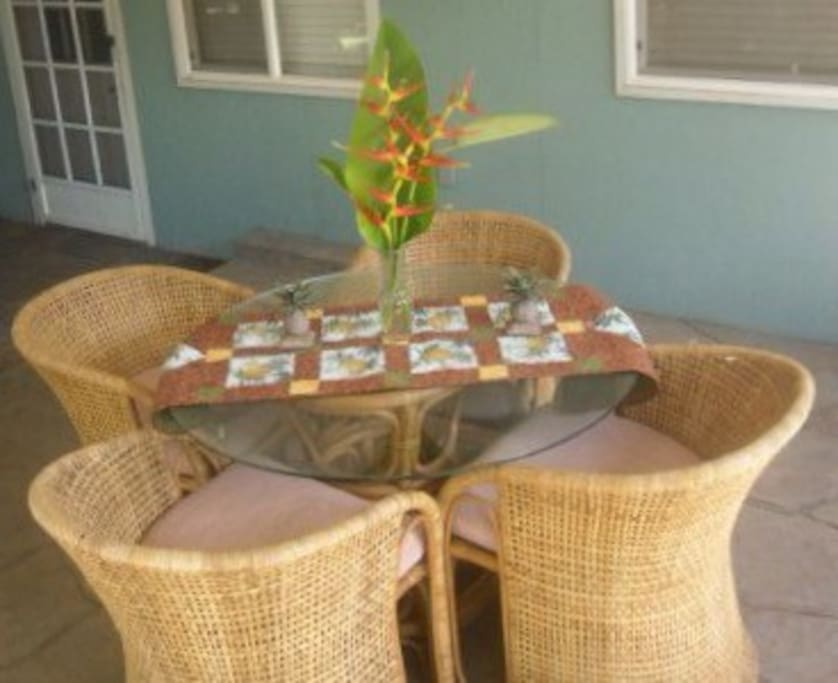 Outdoor dining area that seats four